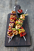 Barbecue skewers on a wooden chopping board