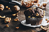 A chocolate muffin with walnuts