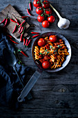 Pasta arrabiata with chilli peppers and cherry tomatoes