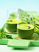 Glasses of parsley and spinach juice