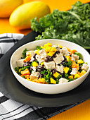 Vegan vegetable salad with kale, tofu and mango