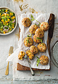 Salmon and potato patties with mango salad