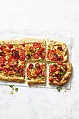 Cheesy tomato tart, sliced