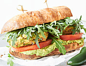 Falafel and guacamole sandwiches with rocket