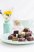 Chocolate pralines with pistachios and marzipan