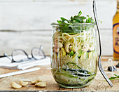 Apple and cucumber noodle salad in a glass