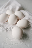 White eggs on a white background