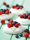 Mixed berry meringue nests