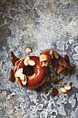 Gluten-free mini doughnuts with cinnamon glaze and flaked almonds