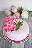 A fondant cake decorated with peonies