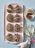 Homemade chocolate Easter eggs filled with biscuits