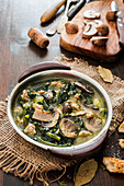 Soup with mushrooms, sausage and kale