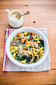Vegetables soup with pasta and Parmesan