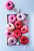 Pink and red-glazed doughnuts