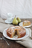 Pear and almond cake dusted with icing sugar
