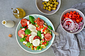 Italian-style pasta salad with olive oil basil mozzarella and olives
