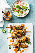 Apricot chicken kebabs with pickled carrot and rice salad