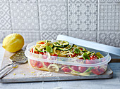 Spaghetti salad with tomatoes and courgettes to take away