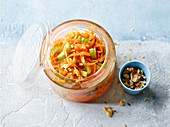 Carrot salad with celery, ginger and nuts to take away