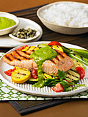 Grilled salmon with vegetables and salsa verde