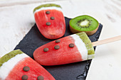 Watermelon ice lollies made with coconut milk and kiwi