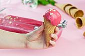Hugo raspberry ice cream in a cone