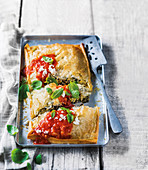 A vegetable pasty with ricotta and tomato sauce