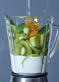 Ingredients for kiwi-melon frozen yoghurt in a blender