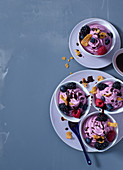 Frozen yoghurt with berries and chocolate sauce