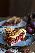 A slice of plum and pecan pie