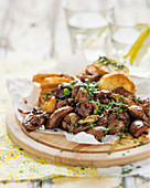 Caramelized lamb kidneys with potato wedges