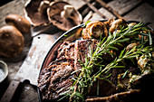 Meat with mushrooms and rosemary