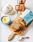 Banana bread slices with orange yoghurt