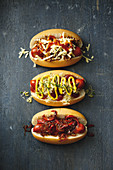 Spicy chilli dogs; Sauerkraut, pickle and mustard hot dogs; Hot dogs with sweet onion and capsicum relish