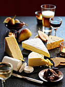 A cheese board with fruit and wine
