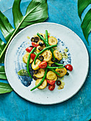 Samoan plantain leaf salad with green beans, tomatoes and olives
