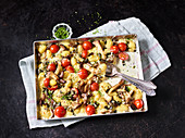Oven-baked vegetarian gnocchi with Appenzeller cheese, mushrooms and tomatoes