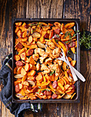 Oven-baked cajun chicken with sweet potatoes and chorizo