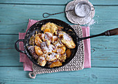 Semolina hash with mandarins in a pan