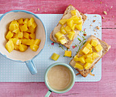 Wholemeal toast with almond butter and diced mango