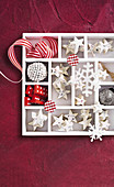 White chocolate stars with nuts and Christmas decorations in a box