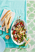 Mediterranean chicken salad with feta cheese and almonds