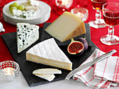 A cheese plate on a festive table