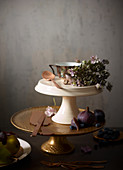 Autumnal fruits and flowers on various cake stands