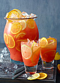Campari Milano punch with ice cubes