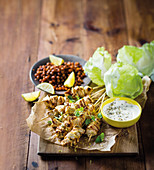 Roasted chicken kebabs with roasted chickpeas, yoghurt, and iceberg lettuce