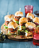 Mini sausage burgers with tomato salsa