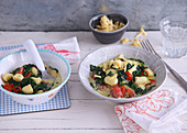 Vegetarian one pot gnocchi with spinach and cherry tomatoes