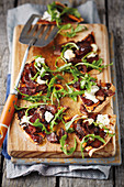 Biltong pizza with rocket and feta