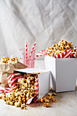 Spiced popcorn in cardboard boxes with napkins